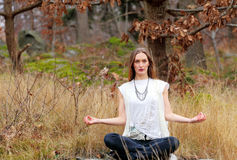 Yoga girl in forest Stock Photo