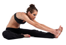 Yoga girl forward bend Royalty Free Stock Photo