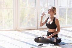 Free Yoga Girl Having Break While Morning Exercising, Drinking Water Stock Image - 163756241