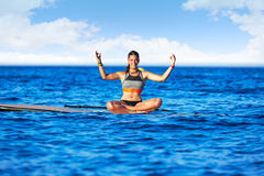 Yoga girl over SUP Stand up Surf board Stock Images