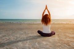 Yoga girl on practice. Girl yoga position on the beach Stock Image