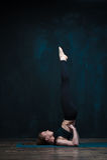 Yoga girl practicing advanced asana indoors. Stock Images
