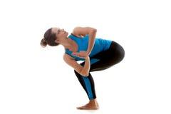Yoga girl practicing. Sporty yoga girl on white background bending looks up Stock Images