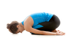 Yoga girl resting. Sporty yoga girl on white background relaxing after practice Stock Image