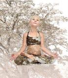 Yoga girl sitting lotus position Royalty Free Stock Image