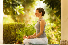 yoga girl in the summer tropical park pose meditation Stock Image