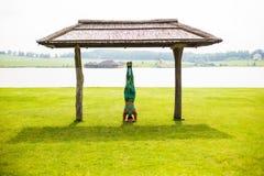 Yoga girl training outdoors on nature background. Stock Photos