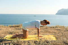 Yoga girl with wireless headphones Stock Image