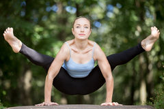 Yoga girl working out in forest Stock Images