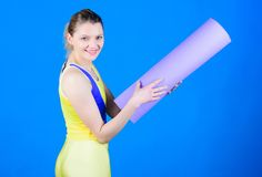 Yoga gives energy. Happy woman workout with fitness mat. Health diet. Success. Sport mat equipment. Athletic fitness stock photography