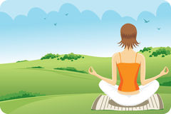 Yoga at the grass. Women who do yoga nature green landscape in the face Royalty Free Stock Photo