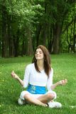 Yoga on grass Royalty Free Stock Photography