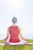 Yoga on green grass Royalty Free Stock Photo