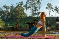 Yoga greeting the sun Royalty Free Stock Photography