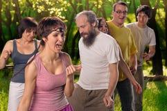 Yoga group doing dance Stock Image