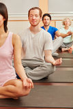 Yoga group meditating in class Royalty Free Stock Images