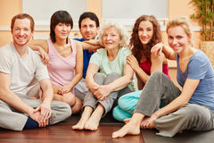 Yoga group with senior woman relaxing Stock Photo