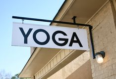 Yoga Gym Sign. A Yoga sign outside of a exercise facility where Yoga is taught Royalty Free Stock Photo