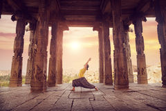 Yoga in Hampi temple. Woman doing yoga in ruined ancient temple with columns, Hampi, Karnataka, India Royalty Free Stock Photography