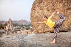 Yoga in Hampi. Woman doing yoga dancer pose near Virupaksha temple in Hampi, Karnataka, India royalty free stock photos