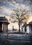 Yoga in Hampi. Woman doing yoga near ancient ruins on Hemakuta hill in Hampi, Karnataka, India royalty free stock photography