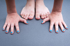 Yoga hands and feet Stock Images