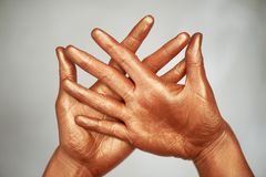 Yoga for hands is wise.Wise Cup chandman. Hands, in gold paint. royalty free stock images