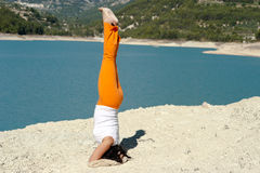 Yoga handstand. Fit and balanced woman doing a yoga handstand outdoors Royalty Free Stock Image