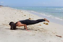 Yoga Handstand on the beach stock image Stock Photo