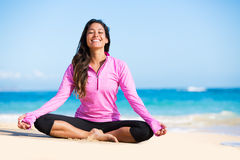 Yoga. Happy relaxed young woman practicing yoga outdoors at the beach. Healthy natural lifestyle Stock Photos