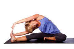 Yoga head to knee pose Royalty Free Stock Photos