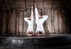 Yoga headstand. Yoga of women and men doing shirshasana headstand in white cloth in yoga hall, Varkala, Kerala, India Royalty Free Stock Image