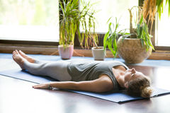 Yoga at home: Shavasana Pose Royalty Free Stock Photography