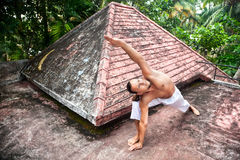 Yoga horizon pose on the roof Stock Image