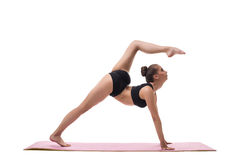 Yoga. Image of harmonous girl showing exercise Royalty Free Stock Image