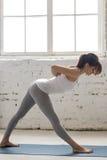 Yoga Indoors: Ardha Parshvottanasana Pose Stock Photo