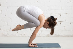 Yoga Indoors: Bakasana Stock Images