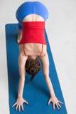 Yoga indoors: downward facing dog pose Royalty Free Stock Image