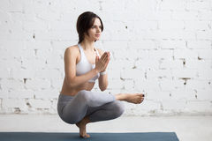 Yoga Indoors: Half Lotus Toe Balance Stock Photo