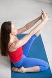 Yoga Indoors: Heron Pose Royalty Free Stock Photography