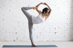 Yoga Indoors: Lord of the Dance Pose Stock Images