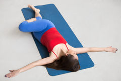 Yoga Indoors: Revolved Abdomen Pose Stock Images