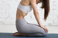 Yoga Indoors: Upward Abdominal Lock Royalty Free Stock Image