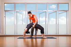 Yoga instructor assisting student perform Backbend or Chakrasana Royalty Free Stock Photos