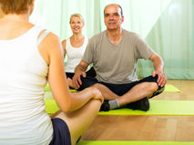 Yoga instructor with elderly attenders Royalty Free Stock Photo