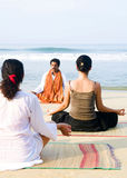 Yoga Instructor And His Students By The Beach Stock Photography