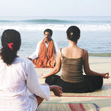 Yoga Instructor And His Students By The Beach Concept Royalty Free Stock Images