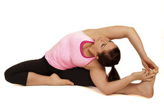 Yoga instructor in seated side stretch pose Parsva Stock Photos
