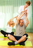 Yoga instructor showing asana to mature couple Royalty Free Stock Photo
