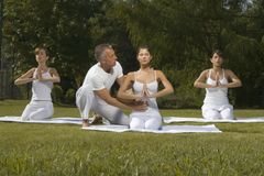 Yoga instructor with three young women stock photo